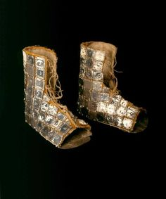 This pair of silver embellished ataderos (ankle boots) from the ancient Chimu culture (12th - 15th century) is the only known pair in existence which could have been worn. The other 3 known examples are miniatures. Chimu craftsmen excelled at metalwork and the use of precious metals such as silver was limited to goods for the upper classes. These boots would have been very labour intensive to create and would have been intended for an elite burial. ~Bata Shoe Museum