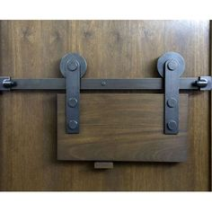 Sun Valley Bronze - 4' - 12' Standard Lengths Barn Door Track brings rustic chic to a traditional or modern wood or glass door. (DPHA Innovative Hardware Product of the Year 2013) Additional Lengths Available Shown in W3 Dark Grey; 9 other finishes offered.