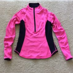 Lululemon 1/2 Zip Pullover Lululemon 1/2 Zip Pullover. Bright pink and black provides great visibility when exercising outdoors. Thumb holes. Higher collar. Inside back pocket for your phone, iPod, etc. size 4. Excellent condition.  #214 lululemon athletica Tops