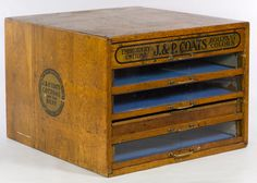 Lot 134: J&P Coats Cotton Oak Spool Cabinet; Having five pullout drawers (three with glass fronts); stamped company label on the top and sides