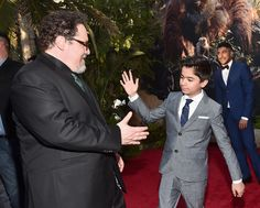 Hi-Five from Neel Sethi (Mowgli) to #JungleBookEvent: Director Jon Favreau during the Red Carpet World Premiere of The Jungle Book. El Capitan, Hollywood, April 4, 2016