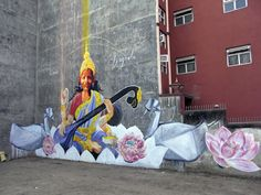 Collaboration mural with Dustin Spagnola of the goddess of education Saraswati at Trinity College Photo by DAAS Daas artwork on Kolor Kathmandu project at Nepal