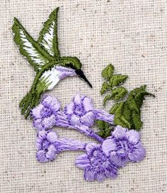 """Hummingbird with Flower Iron on Applique High quality, detailed embroidery applique. Can be sewn or ironed on. Great for bags, hats, clothing, and more! Measures 1-3/4"""" x 2-1/2"""" or 4.4cm x 6.35cm"""