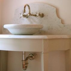 wall mounted faucet and ogee marble backsplash