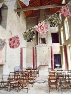 Exquisite wedding storyboard ~ I love the fabric banners and flower arrangements