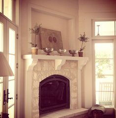 A corner fireplace here could actually work, we would have to put new french doors in but it would allow for the large room to be the living room Classic Fireplace, Home Fireplace, Fireplace Surrounds, Corner Fireplaces, Beverly House, Mantle Styling, Limestone Fireplace, Wood Burner, Home And Living