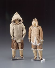 Inuit Dolls in Caribou and Sealskin Clothes Made August 1934 Akudnermiut Inuit Clyde Inlet, Baffin Island, Nunavut, Canada