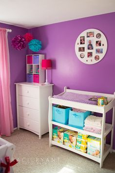 pink and purple nursery inspiration, love the organization under the changing table!!