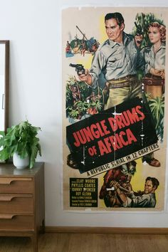 """""""Our favorite thing in the bedroom is the giant movie poster."""" Nick found the vintage poster at an antique store, and the paper was so brittle that the couple had it mounted on board so that they could hang it on their wall."""