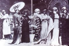 1910's  Oriental and Russian influence. Woman in center of photo has a Dolman or Charmeuse Coat.  Sleeves cut in one with the body of the coat.
