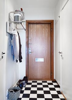 Small foyer. Why not hang a shelf up high?