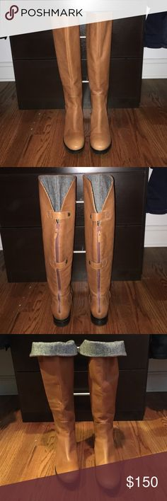 Waterproof Cole Haan Natural Leather Riding Boots Beautiful Waterproof Cole Haan natural leather riding boots.  Top third lined with herringbone wool.  Can be worn cuffed or uncuffed.  Back zipper and two button enclosure.  Extremely comfortable Nike soles.  Worn 3 times and in excellent condition. Cole Haan Shoes Winter & Rain Boots
