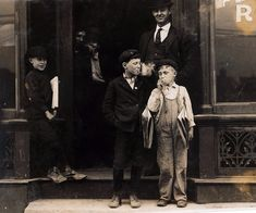 Newsies smoking outside a pool room, The smallest boy is 9 years old and sells until 9 PM, St. Louis, by Lewis W. Hine 1910