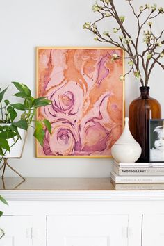Add a one-of-a-kind swirl of color to any room with #DIY marbled-paper wall art.
