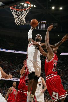 LeBron James dunking against the Chicago Bulls at the Q.