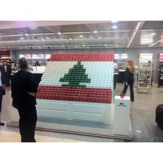 Lacoste formed a Lebanese flag at Beirut Airport using the red, white, & green of their perfume boxes