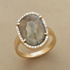 Lavish Labradorite Ring  Gleaming diamonds rim the irregular border of a faceted slice of labradorite, an opulent combination set in 14kt gold. Each ring is unique. Stone size and shape will vary.