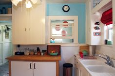 Blue walls + red accents + subway tiles + vintage sink & cupboards ... when can I move in?