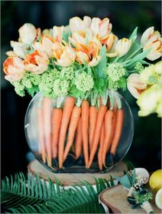 Easter table setting, Easter tablescape, Easter decor, Easter bouquet, Orange tulips and carrot arrangement for a funky addition to your dinner or reception table. Captured By: Kirill Bordon Fresh Flowers, Spring Flowers, Beautiful Flowers, White Flowers, Cascading Flowers, Simple Flowers, Exotic Flowers, Tropical Flowers, Yellow Roses