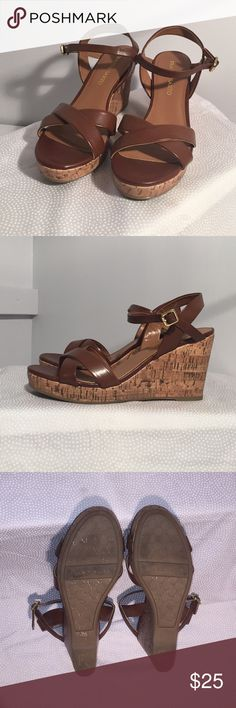Wedges Leather upper in a wedge sandal with an open toe. Heel sling strap with adjustable buckle. 1 inch platform 4 inch wedge heel. Worn once very good condition. Franco Sarto Shoes Wedges