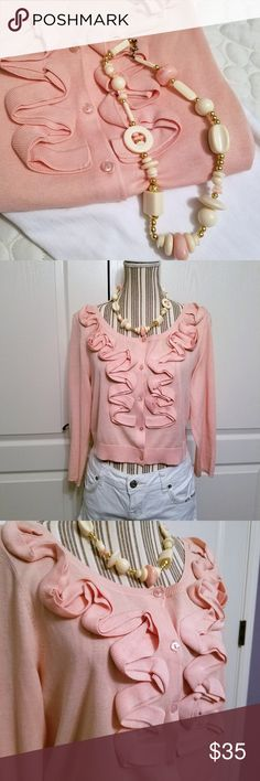 Antonio Melani Silk Ruffle Feminine Shrug Antonio Melani Women's Silk Ruffle Feminine Shrug Cardigan Sweater Peach Pink. In EUC! 70% silk/30% cotton Ruffle Button down Three quarter sleeve  Get the look on the cover photo!!  White jeans/capris pants and necklace are available in my closet. Bundle the sweater, jeans, and necklace together to save  $20!! ANTONIO MELANI Sweaters Shrugs & Ponchos