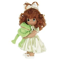 This emerald-eyed Precious Moments doll has pretty auburn curls, and comes with her plush froggy friend that has Velcro on his front feet, and a wide smile as he anticipates a sweet smooch! Description from flossiesgifts.com. I searched for this on bing.com/images