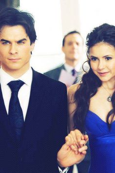 """Elena looks so happy and the Damon is like """"yeah I know I have a beautiful gf, deal with it."""""""