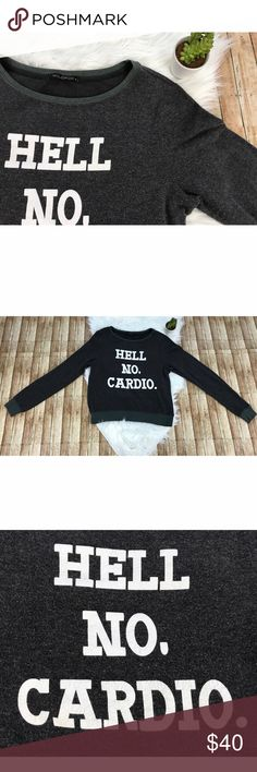 """Wildfox """"Hell No Cardio!"""" Pullover Wildfox """"Hell No Cardio!"""" Pullover. Is meant to have the worn and distressed look. The letters are slightly cracked. Material is very soft. The Body is gray and sleeve cuffs and bottom trim are an army green color. comes from a smoke free, pet friendly home. 🚫NO TRADES!  Measurements: -Bust: 19"""" -Shoulder to Shoulder: 16"""" -Top To Bottom: 23.5"""" -Armpit To Bottom: 15"""" Wildfox Tops Tees - Long Sleeve"""