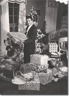 A young Elvis Presley celebrating Christmas at Graceland. #vintage #Christmas #Elvis