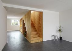 Eclépens apartment interiors with boxy wooden furniture by Big-Game