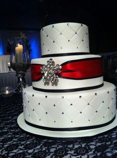 "Red black and white wedding cake...One more layer perhaps and maybe a BLINB BLING ""S"" on top or Entwined Hearts?  I love the center sash and easy combo! #weddingcakes"