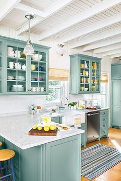 the color of the kitchen cabinets is a mix of baby blue and green