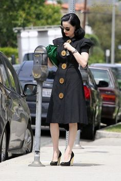 Dita Von teese Casual vintage. Love the big buttons and the puff sleeve..