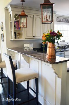 11 magnolia lane kitchen with creamy off white cabinets copper lanterns and black - White Kitchen Cabinet Images