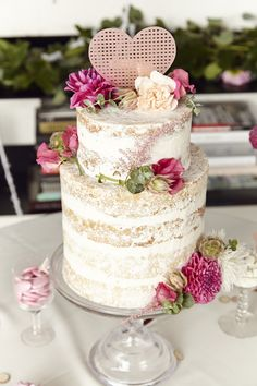 Naked wedding cake perfection - love that heart cake topper!