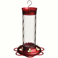 The Diamond Hummingbird Feeder features a spiral glass bottle and a built in ant moat with a large 30 ounce capacity.