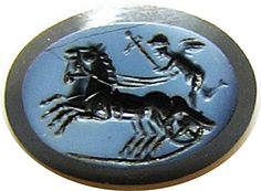 This is a fabulous ancient Roman Nicolo onyx intaglio, dating to the late 1st century B.C. The intaglio is finely cut on a layered Arabian Onyx gemstone, one of the most highly prized of intaglio gems, of the late Republic. Here we see Eros (Cupid) riding at haste in a biga chariot, drawn by two lively horses. You can feel the urgency and speed, as Eros with a thyrsus as a whip urges his two steeds onward - no doubt to a Bacchanalian party!
