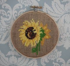 A sunflower made for a friend's mom for Mother's Day. DMC thread, burlap, and embroidery hoop.