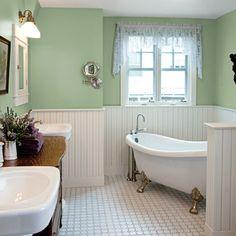 master bath with green walls, claw foot bathtub, white tile floor
