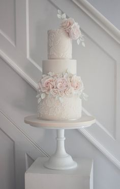 Ivory and lace appliqué wedding cake with david austin roses, english roses and foliage
