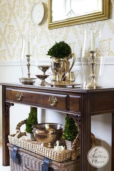 How to Decorate with Collections | Vintage silver on a side table grouped together makes an instant collection that's simple and stylish!