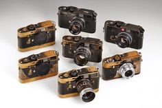 Seven Leica M cameras all owned and used by Magnum photographer Paul Fusco: M2…