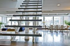 Google Image Result for http://gallegoandco.com/wp-content/uploads/2011/11/Wall-Street-2-unit_entry-stairs-onto-living-661x440.jpg