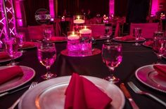 Centerpiece I designed. Very simple. Three different vases with LED lights and stones with floating candles on top of a mirror. JJDJ Entertainment