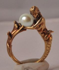 """Arianna"" art deco inspired mermaid ring.  Available in brass and sterling silver. Arianna holds an 8mm black or white pearl.  Now available for purchase.  www.omniaoddities.com"