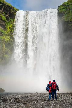 Iceland Skogafoss waterfall Art Print for sale. Couple enjoying the fascinating nature in Southern Iceland. Click on the link or the image to buy a poster, fine art print or canvas print: http://matthias-hauser.pixels.com/featured/enjoying-skogafoss-waterfall-in-iceland-matthias-hauser.html  30 days money back guarantee. Matthias Hauser hauserfoto.com - Art for your Home Decor and Interior Design needs