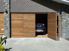 Automated bi-fold Garage doors in American Black Walnut.