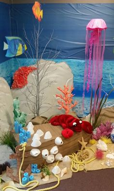 Coral reef: Underwater scene with cardboard boat Coral reef: Underwater scene with cardboard boat Under The Sea Theme, Under The Sea Party, Ocean Diorama, Under The Sea Decorations, Ocean Projects, Ocean Party, Ocean Crafts, Ocean Themes, Kids Church