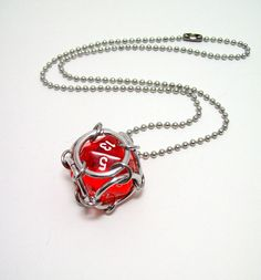 Dungeons and dragons jewelry dice necklace by Eternalelfcreations.....kinda sad to say I want this