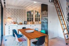 Kitchen with vibrant wallpaper and a chalkboard wall.